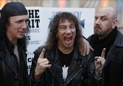 "Robb Reiner, left, Steve  Kudlow and Glenn Five of the band Anvil arrive at the Los Angeles premiere of Anvil! The  Story of Anvil. The attention the heavy metal band has gotten because of the documentary ""is a miracle. Nothing less than that,"" says Kudlow, 53."