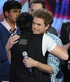Scott MacIntyre is embraced by fellow contestants after he was eliminated from the show Wednesday night.