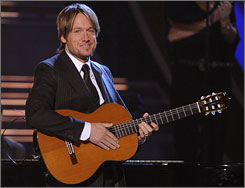 Keith Urban and other musical performers are offering lower-price tickets because of the economic downturn.