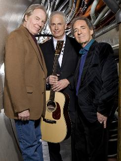Still walking the fine line between stupid and clever: Michael McKean, left, Christopher Guest and Harry Shearer, aka Spinal Tap, return to the road with their Unwigged and Unplugged tour.