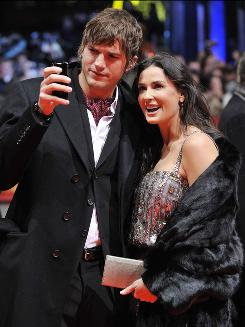 Ashton Kutcher and Demi Moore, on a red carpet in Berlin in February, are members of the Hollywood twitterati. The couple are famous for sending tweets to their tweeps.