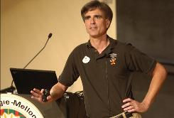 """Randy Pausch talks to a standing-room-only crowd at Carnegie Mellon University on Sept. 18, 2007. The computer scientist's """"last lecture"""" about facing terminal cancer became an Internet sensation and a best-selling book. Pausch died on July 25 at 47."""