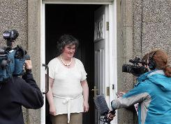 Susan Boyle, 47, greets reporters at her home Thursday in Blackburn, Scotland. Her appearance on Britain's Got Talent and a clip of her performance on YouTube have set off a frenzy of attention.
