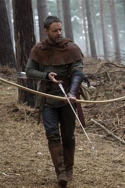 "No more tights: The Robin Hood played by Russell Crowe wears armor and is ""very medieval,"" says producer Brian Grazer."