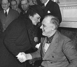 Public life: Frances Perkins shares a joke with incoming president Franklin D. Roosevelt on Jan. 1, 1933. Perkins, the first woman in a presidential Cabinet, had worked for Roosevelt since 1928.
