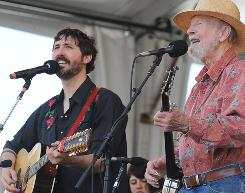 Tao Rodriguez Seeger, left, and Pete Seeger perform at the New Orleans Jazz & Heritage Festival Saturday.
