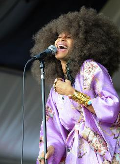 Sheer joy: Erykah Badu performs at the New Orleans Jazz and Heritage Festival.