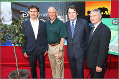 Director Mark Linfield, Disney's Dick Cook, director Alistar Fothergill and Disneynature's Jean-Francois Camilleri arrive at the premiere of Disneynature's Earth held at the El Capitan Theater on April 18, 2009 in Hollywood, Califronia.