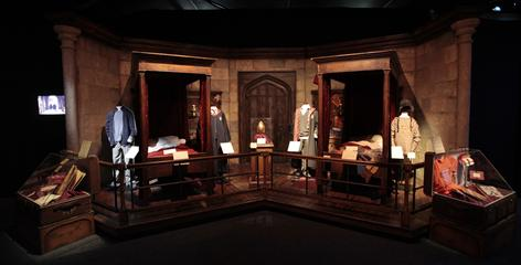 Home sweet home: The exhibit shows where Harry Potter and best friend Ron Weasley sleep in the boys dormitory, along with some of their possessions, including their trunks and school robes.