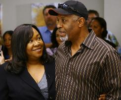 On the set: Shonda Rhimes, Grey's Anatomy's creator, celebrates the show's 100th episode with actor James Pickens (Dr. Richard Webber).