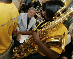 Tony Bennett talks to members of the school band as he visits KIPP Believe College Prep in New Orleans, Thursday.