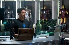 "Unmasked avenger: Robert Downey Jr. is hard at work on Iron Man 2. ""How many superheroes are open about their true identities?"" says director Jon Favreau."