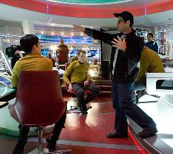 """I was not a huge fan to begin with"": J.J. Abrams, at work on the set of Star Trek, brought a skeptical eye to the movie, opening May 8."