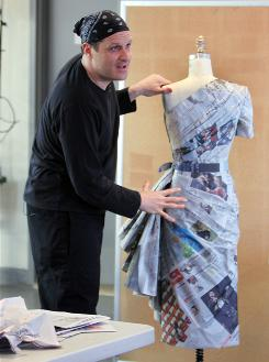 "The design concept: The pleated back of the dress Isaac Mizrahi designed using USA TODAY newpapers is ""beautiful,"" he says. ""It's very important because when you're walking away is when people are probably talking about you."""