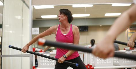 Jane Doyle works out during a total conditioning class. Doyle, who gained weight during two pregnancies, varies her exercise activities.