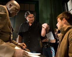 Detective Jack Mitchell (Bill Duke, left) interviews a witness (Andrew St. John), directed by Anthony Zuiker.