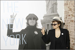 Yoko Ono gestures as she unveils the John Lennon: The New York City Years exhibit at the Rock & Roll Hall of Fame Annex in New York on May 11, 2009.
