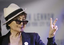 All she is saying: Yoko Ono gives a peace sign a chance at the opening of John Lennon: The New York City Years exhibit at the Rock and Roll Hall of Fame Annex in New York on Monday.