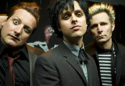 "Tre Cool, left, Billie Joe Armstrong and Mike Dirnt's 21st Century Breakdown arrives Friday. ""Nothing comes easy for us,"" Armstrong says."