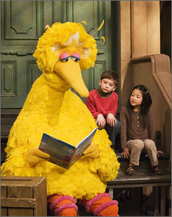 Big Bird reads to Connor Scott and Tiffany Jiao during a taping of Sesame Street in New York.