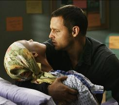 Dead or alive? Alex (Justin Chambers) holds Izzie (Katherine Heigl), whose fate was left up in the air in the season finale after brain surgery to remove a tumor.