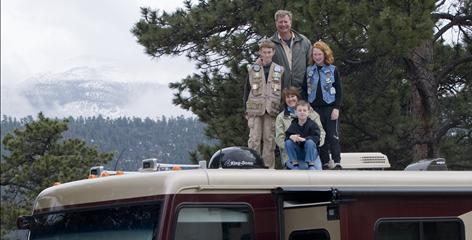 Tom Wahl, wife Mary Claire, son Joe, 12, daughter Anna, 10, and son Sam, 7, are traveling the USA looking for a new hometown. Along their journey, they've been camping in national parks across the USA. Here they pose for a family portrait atop their motor home in Rocky Mountain National Park.
