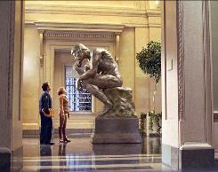 Ben Stiller and Amy Adams (as Amelia Earhart) consult Rodin's The Thinker, which really isn't in the Smithsonian museums, in Night at the Museum: Battle of the Smithsonian, opening nationwide Friday. Exhibits from several Smithsonian museums, and others, were fictionally combined for the film.