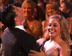 "Beaming: Shawn Johnson celebrates her win with partner Mark Ballas. ""This has been the best day ever,"" she said."