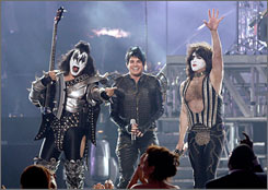 Adam Lambert, center, rocked some serious leather for his performance with legendary rockers Kiss.