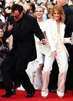 """The Oz of cinema"": And, apparently, of dance parties, as Quentin Tarantino shows off his moves with star Melanie Laurent at Wednesday's premiere of Inglourious Basterds."