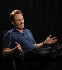 "Hot seat: Conan O'Brien gets comfortable in his new Universal Studios home for The Tonight Show. The anxiety-ridden host with a quirky sense of humor says hosting the NBC staple ""means everything to me."""