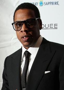 Jay-Z offers some of his own songs for the game and also teams up with Eminem for a track.