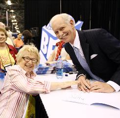 "A doctor and a captain: Ruth Westheimer with pilot Chesley ""Sully"" Sullenberger at his signing."