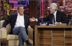 Jay Leno, here interviewing Mel Gibson, will launch his new prime-time talk show in September.