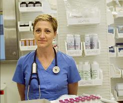 Edie Falco, who won three Emmys for her role as Carmela Soprano, is relishing the change of pace as Nurse Jackie  as well as freedom from the mafia matriarch's high-maintenance hair and nails.
