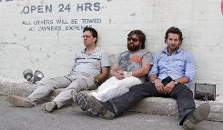Ed Helms, left, Zach Galifianakis and Bradley Cooper try to find their missing friend in The Hangover.