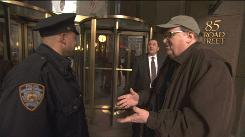 Filmmaker Michael Moore outside Goldman Sachs headquarters in Manhattan. Wall Street is among the targets of Moore's upcoming documentary film, which opens Oct. 2.