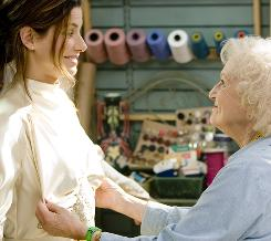 "Proposal's Betty White feels around Sandra Bullock for her breasts while altering a baggy wedding dress. ""It's like an Easter egg hunt,"" White says."