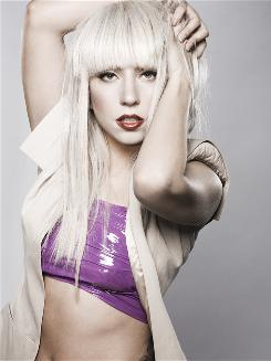Lady Gaga, who sings openly about her sexuality, says she is flattered to be compared with Madonna.