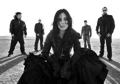 Three Evanescence guys, an Idol and a bassist:  Rocky Gray, Ben Moody, Carly Smithson, Marty O'Brien, John LeCompt.