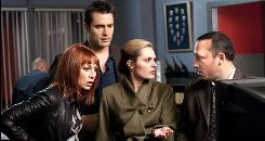 Stella (Sadie LeBlanc, left), Vic (Victor Webster), Lacey (Maggie Lawson) and Detective Harding (Jason Schombing) untangle a mystery in the Lifetime Movie Network's Killer Hair, which airs Sunday.