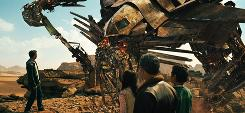 Props to: Sam Witwicky (Shia LaBeouf) speaks with the Autobot Jetfire as Mikaela Banes (Megan Fox), Agent Simmons (John Turturro) and Leo (Ramon Rodriguez) look on.
