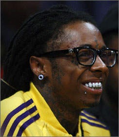 Lil Wayne, whose real name is Dwayne Carter, faces drug possession and weapons charges.