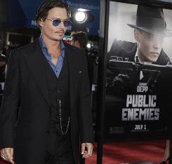 Johnny Depp arrives at the premiere of Public Enemies Tuesday. He plays legendary bank robber John Dillinger.
