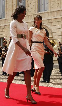 """A modern woman"": Michelle Obama shows off two of her style staples  a sheath dress and a belt  during an arrival ceremony June 6 with French first lady Carla Bruni-Sarkozy in Caen, France."