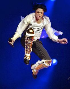 Above the rest: Jackson performs at the world-famous Apollo Theater in 2002 at a benefit concert.
