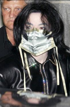  Michael Jackson wears a surgical mask as he leaves a gallery in Berlin in 2002. 