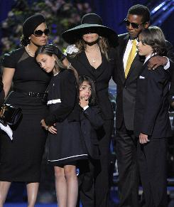 Family pulls together: Janet, left, La Toya and Jackie Jackson comfort Michael Jackson's children, daughter Paris and sons Prince Michael II and Michael Joseph Jr.