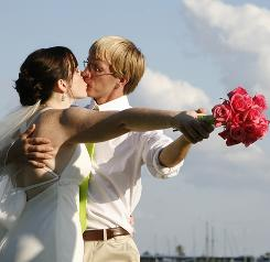 Dearly budgeted: Heather Strickland and Jae Trese after their wedding May 30 at a recreation center in Florida.