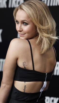 "Well, maybe there's one regret. Hayden Panettiere's tattoo was supposed to spell out ""Vivere senza rimpianti"" (To live without regrets). But the tattoo artist put an extra ""i"" after ""m."""